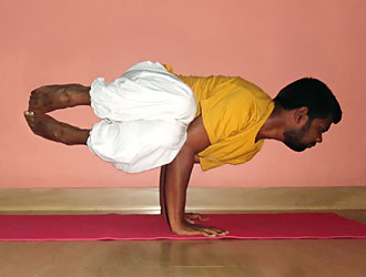 Parsva Bakasana Yoga Master Kannan at School of Santhi Yoga Teacher Training School in India